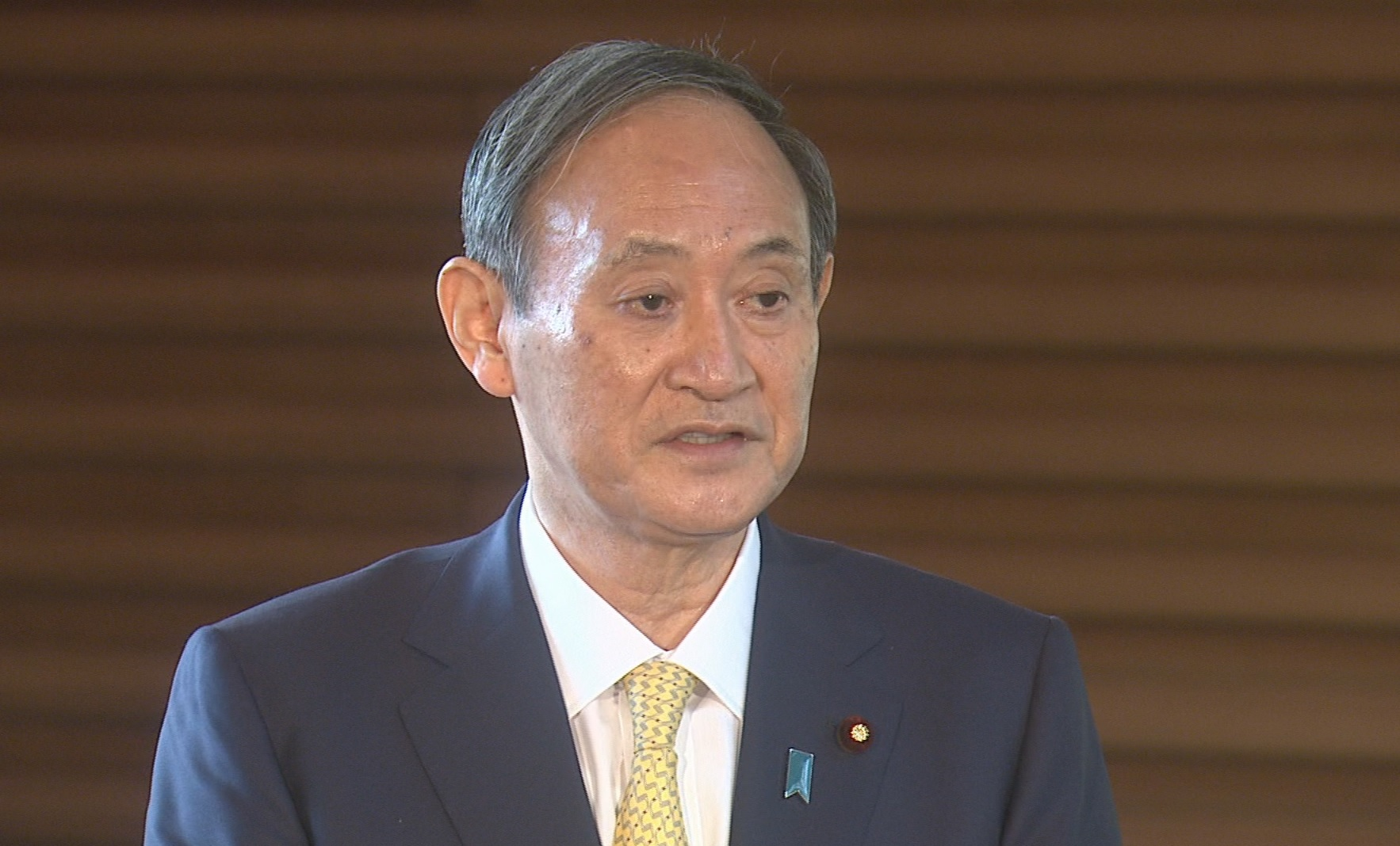 Photograph of the Prime Minister holding the press conference