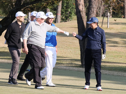 Photograph of the leaders playing golf (1)