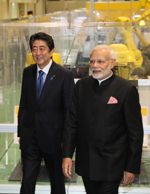Photograph of the two leaders visiting a company