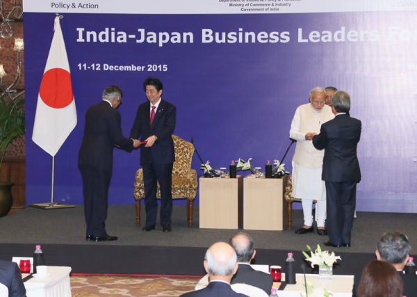 Photograph of the leaders receiving the joint report from the Business Leaders Forum