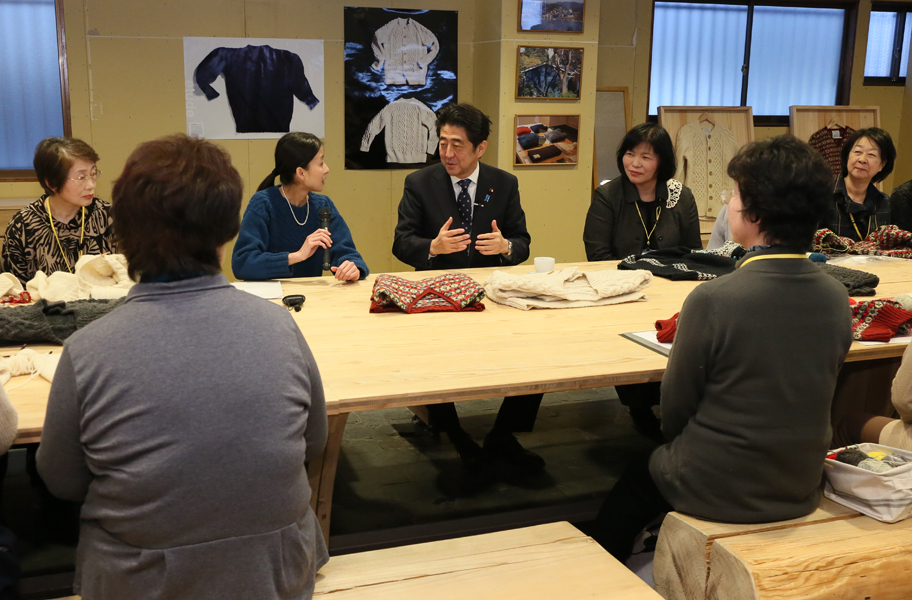 Photograph of the Prime Minister visiting makers of hand-knit items