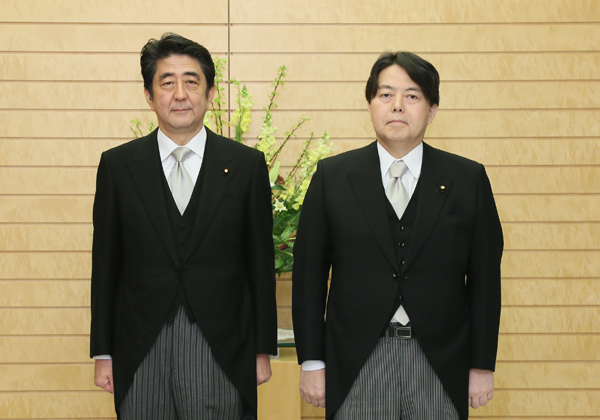 Photograph of the Prime Minister attending a photograph session with the newly appointed Minister Hayashi