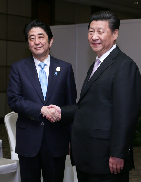 Photograph of the Prime Minister shaking hands with the President of China