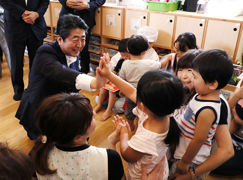 Photograph of the Prime Minister visiting a childcare center