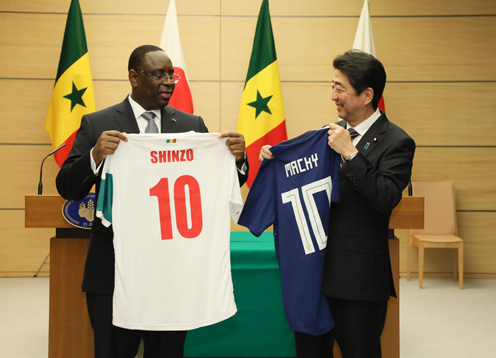 Photograph of the leaders exchanging uniforms (1)