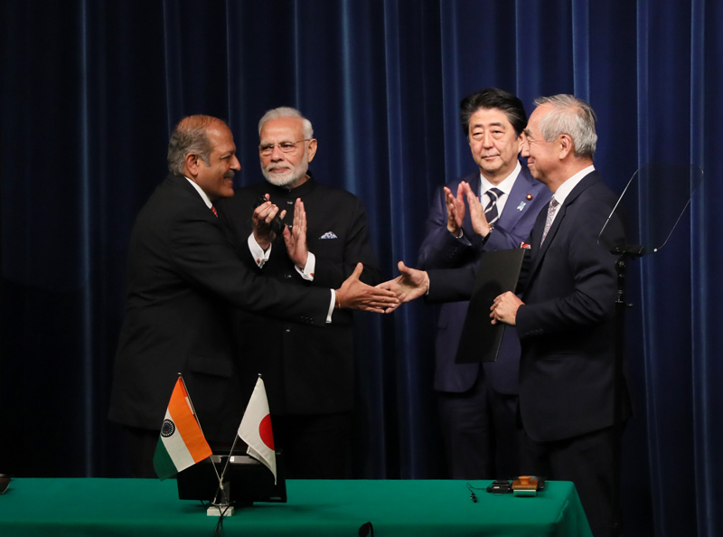 Photograph of the ceremony for signing and exchange of documents