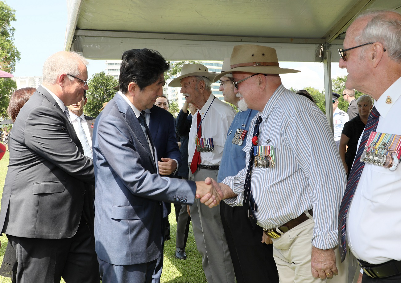 Photograph of the Prime Minister shaking hands with Australian veterans