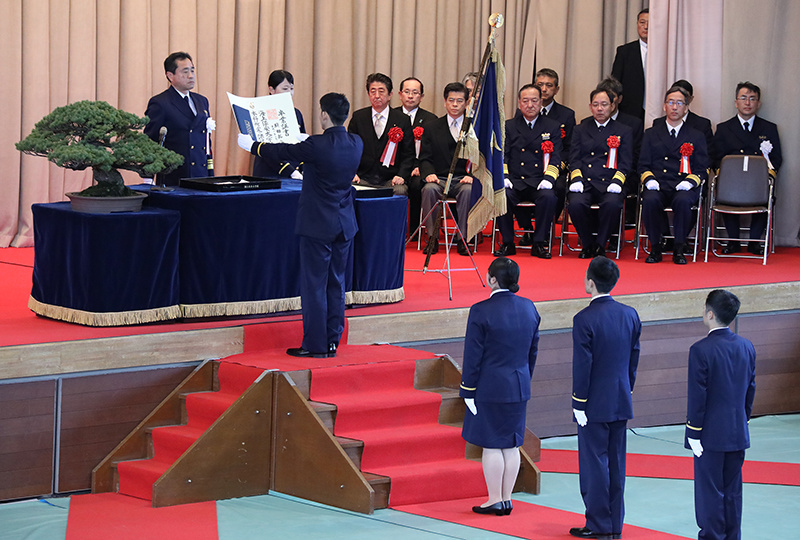 Photograph of the Prime Minister overseeing the graduation ceremony