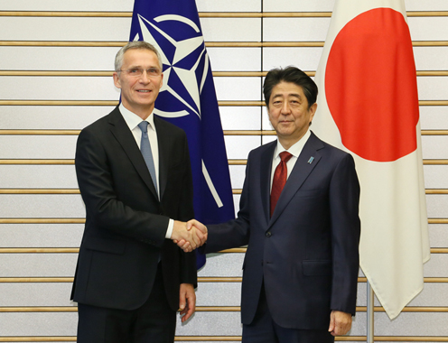 Photograph of the Prime Minister shaking hands with the NATO Secretary General